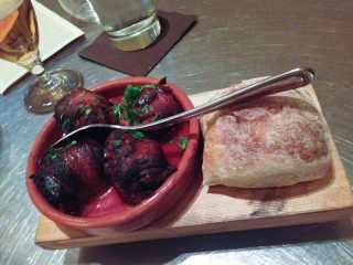 chorizo-stuffed medjool dates with bacon and piquillo pepper-tomato sauce