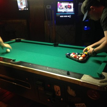 Playing pool at Alligator Lounge in New York.