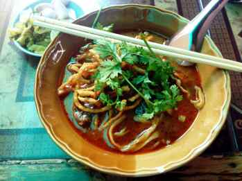 I had Khao Soi for lunch two days in a row while I was in Chiang Mai. I should have stayed and eaten it every day.