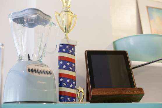 I keep my iPad in my kitchen so, in theory, I will use it for recipes. I also keep my hot dog eating contest trophy in there too.