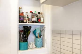Shelves of utensils and bottles.