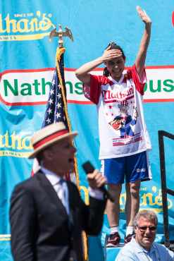 Sonya Thomas eats at the 2016 Nathan's Famous hot dog eating contest at Coney Island.