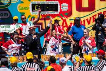 Juliet Lee comes in third at the Nathan's Famous July Fourth hot dog eating contest.