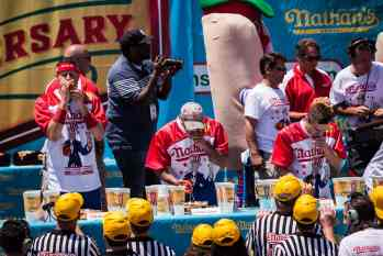 Geoff Esper eats at the 2016 Nathan's Famous hot dog eating contest at Coney Island.
