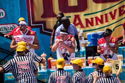 Brian Dudzinski eats at the 2016 Nathan's Famous hot dog eating contest at Coney Island.