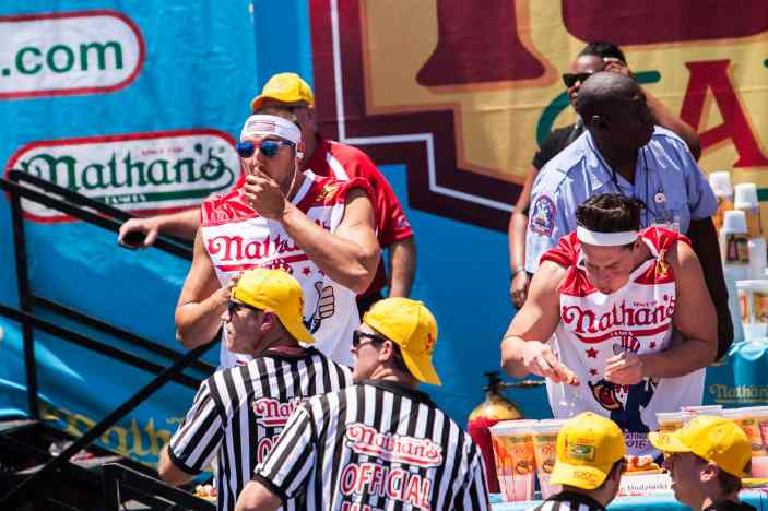 Steven Schuster eats at the 2016 Nathan's Famous hot dog eating contest at Coney Island.