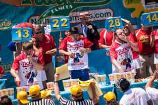 Matt Stonie eats at the 2016 Nathan's Famous hot dog eating contest at Coney Island.
