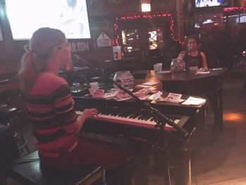 Dueling pianos at Sluggers Bar in Chicago.