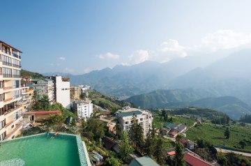 Bamboo Sapa Hotel pool with mountain view