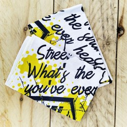 Handmade and reusable table napkin with black and yellow patterns from La Parenthese d'Yllen