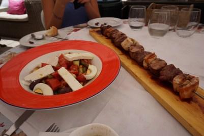 Chicken kabab, and greek salad.
