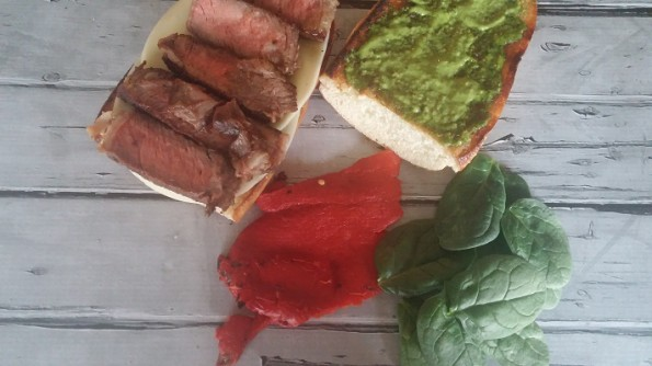 Rib Eye Steak, Provolone Cheese, Roasted Red Pepper, Baby Spinach, Pesto Mayo, Sub Roll