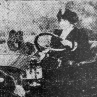 1912 Actress Grace La Rue with a chow in her roadster