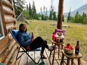 Snacks & drinks on cabin porch, while icing foot, after Mt. Darby hike