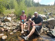 Filtering water and soaking feet in cold stream