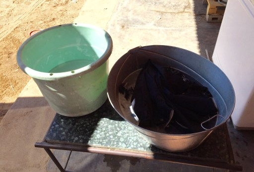Wash basin on the right and rinse bucket on the left. Best technique, they say, is to rub the fabric on your forearm rather than on another part of the garment.