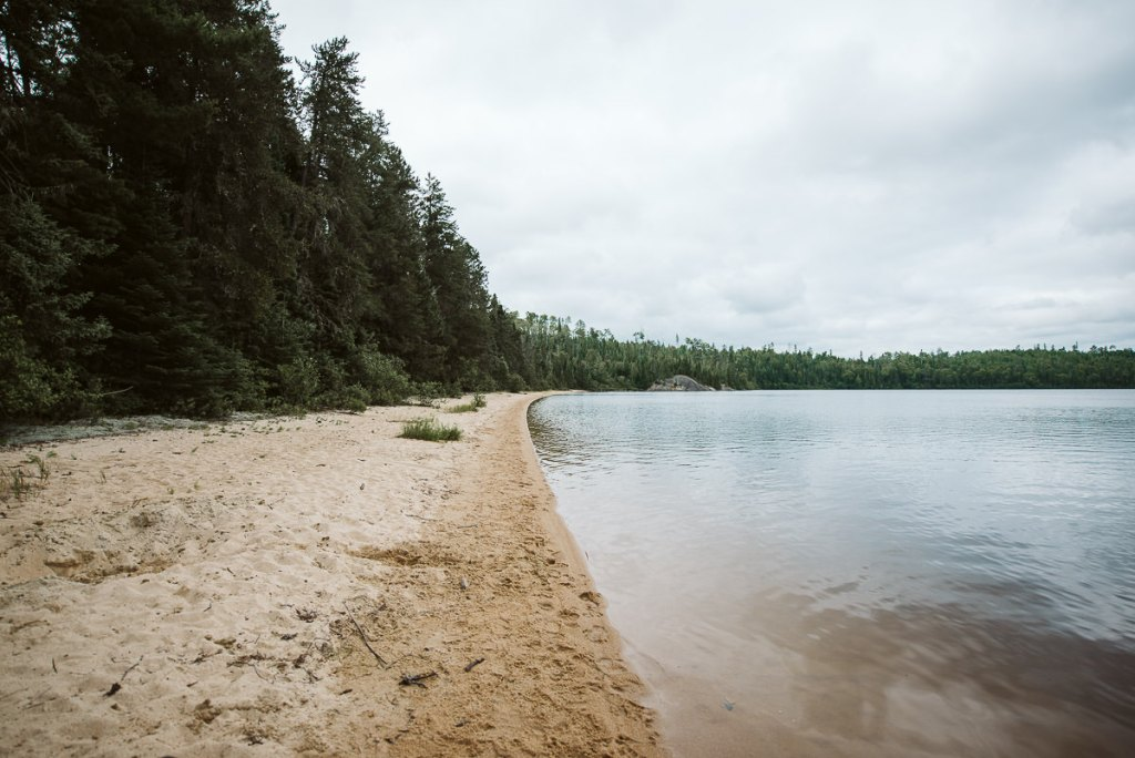 A beautiful white sand beach largely untouched by humans on Pickerrel Lake where you can back country camp for the night.