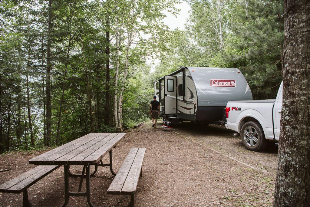 Camping in a waterfront site in Quetico Provincial Park with a Coleman RV.