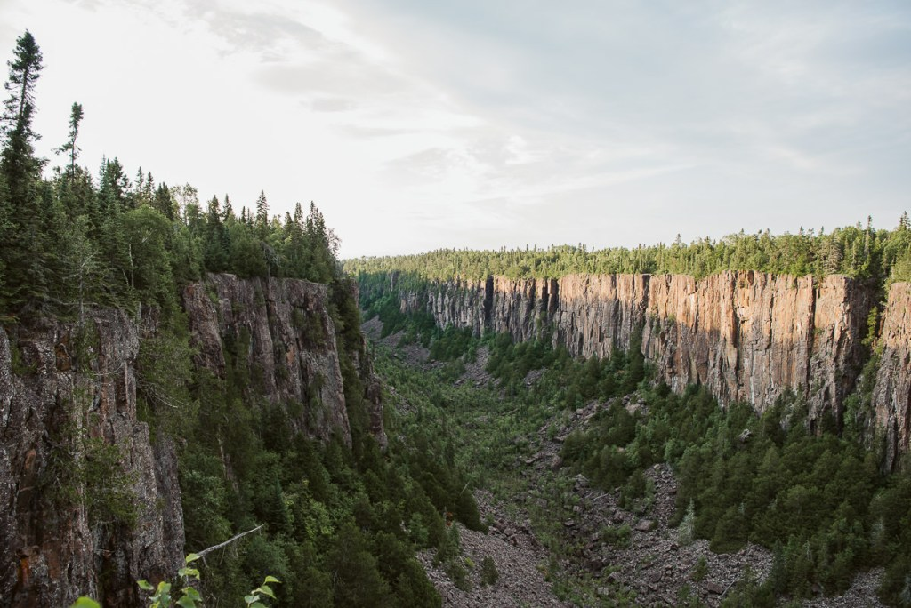 The sun setting on the deep rock gorge of Ouimet Canyon located outside of Thunder Bay in Northern Ontario.