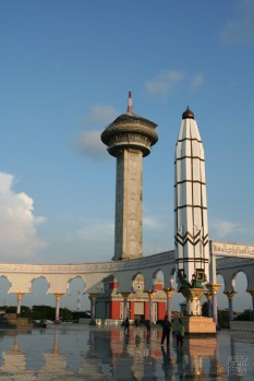 asmaul husna tower behind the umbrella