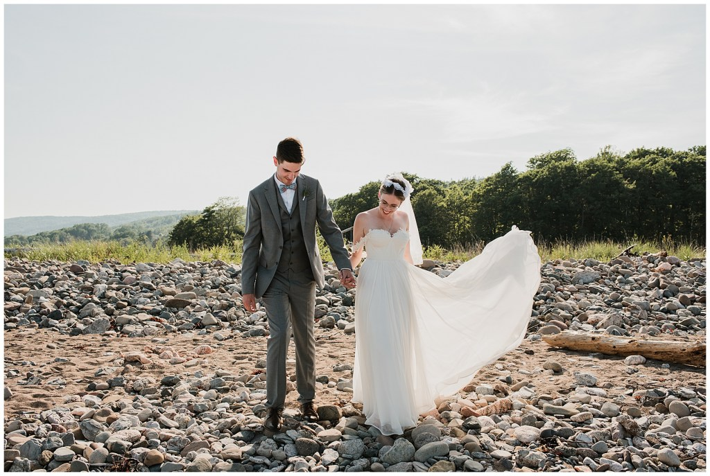 Bride and Groom on Beach at Crystal Cliffs Wedding Venue