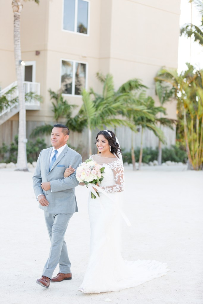 Bride walking down the aisle with her father during her outdoor wedding ceremony. Choosing the perfect wedding ceremony time for your wedding day   Chris Sosa Photography