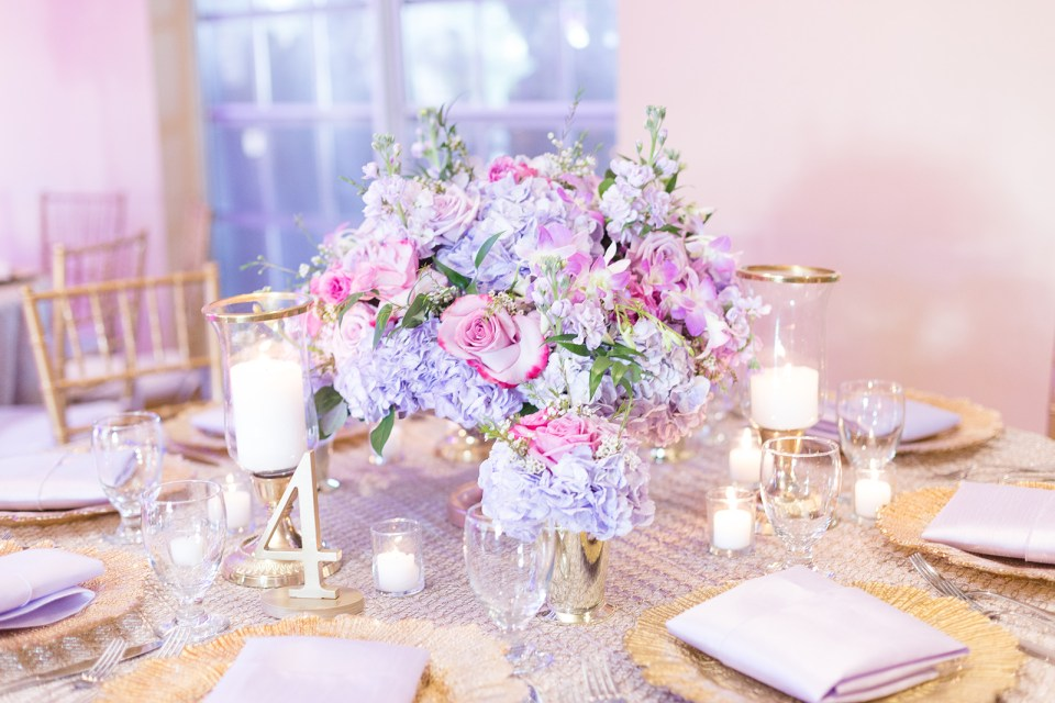 pink and purple flowers on table