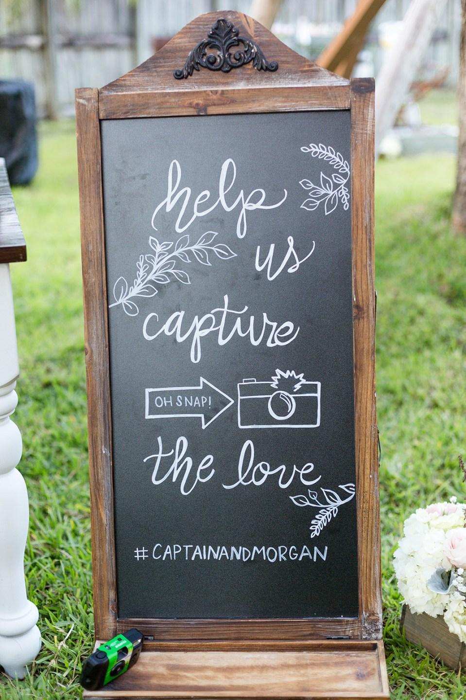 chalk board sign saying help us capture the love