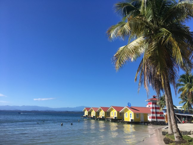 Picture of yellow buildings on the waterfront near Black Rock Beach on Carenero Island in Bocas del Toro