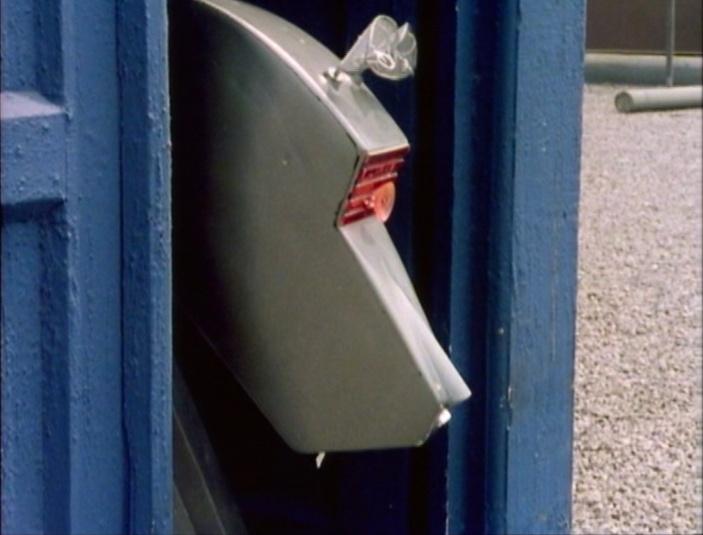 K-9, peering from the TARDIS door