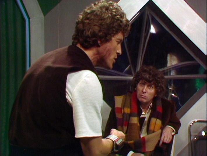 Stott (Barry Andrews) and the Fourth Doctor (Tom Baker)