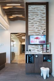 Coffee station with a small stool that looks like a tooth at Quail Ridge Dental office,