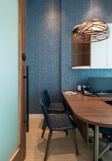 Modern office with blue walls at Kelowna Dental clinic.