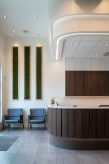 Part of reception area with waiting area to the left at Quail Ridge Dental in Kelowna, BC.