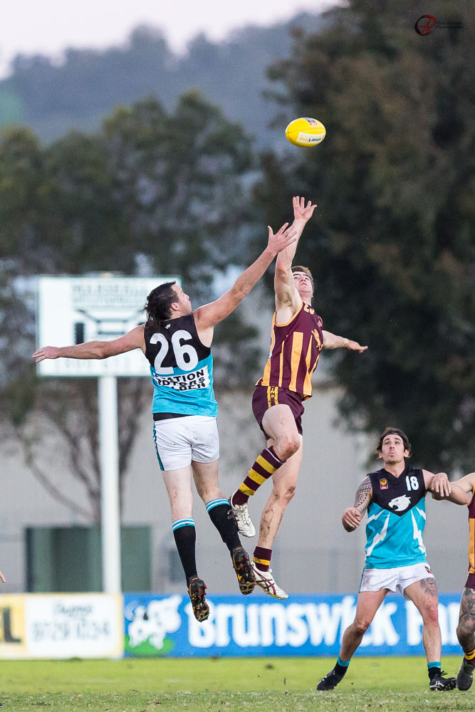 Going for the ball - footy photography