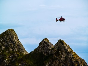 Rescue Helicopter Flying in to land over Three Cliffs