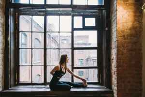 Woman stretching on a window sill