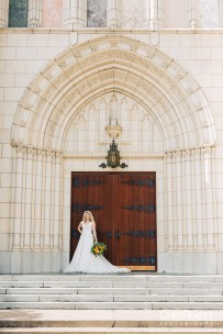 Bride posing with bouquet in front of a church in Fort Worth Texas.