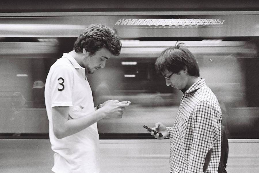 Two men on mobile phones
