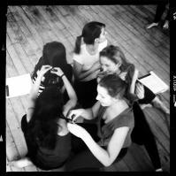 The chorus of women rehearsing a scene.