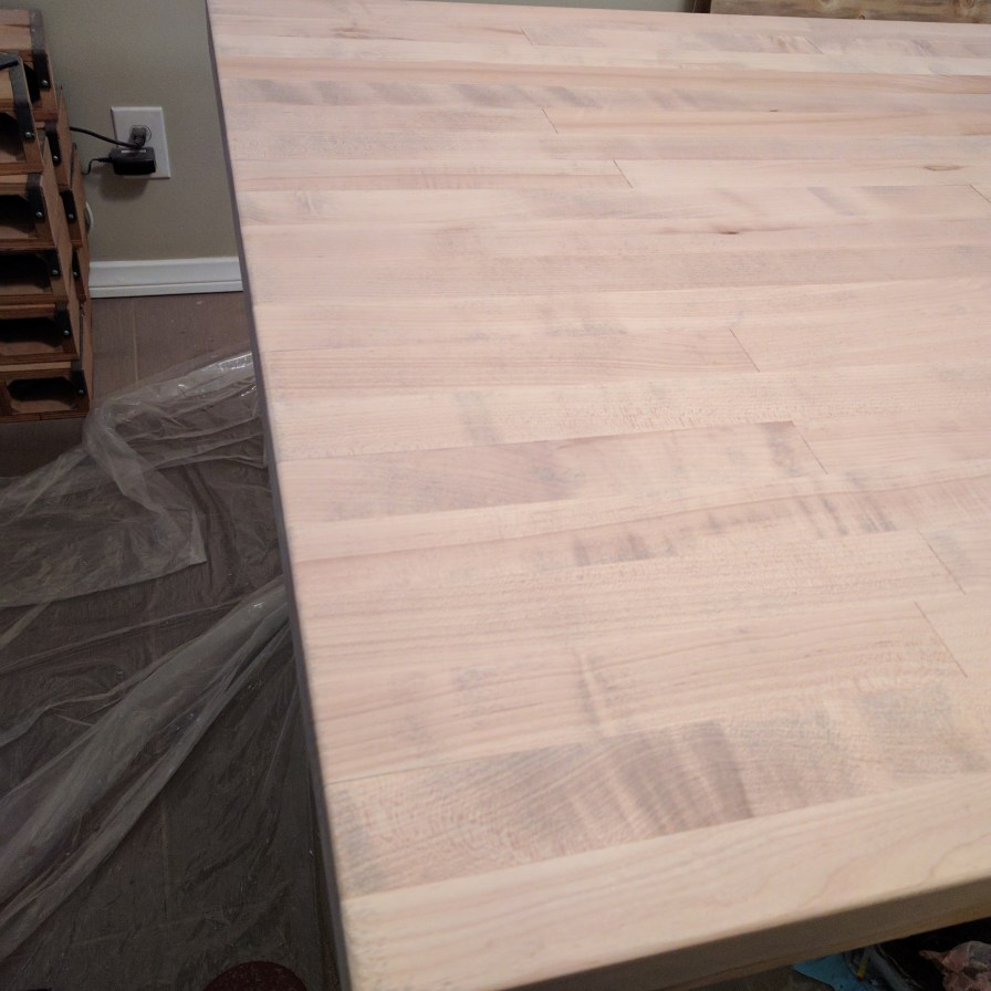 Legs bolted, top sanded, edges and corners softened (rounded) by hand. Pre-stain & polyurethane.