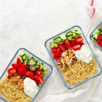 Meal prepping food—like this Greek chicken dish—ahead of time and storing it in reusable containers can help save you time, money, and stress.