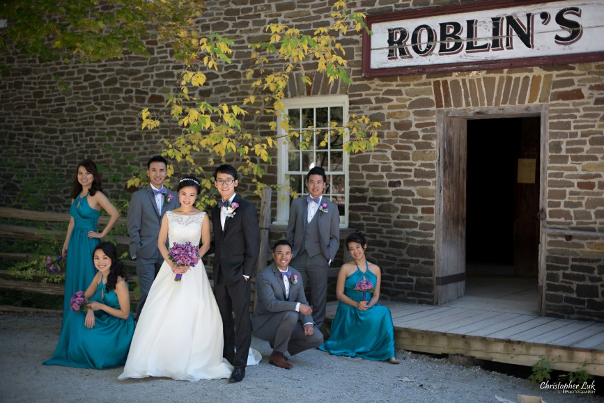 Fall Autumn Wedding Creative Relaxed Portrait Session Photojournalistic Candid Natural Posed Black Creek Pioneer Village Bride Bridesmaids Floral Bouquets Groomsmen Old Mill Entrance Bridal Party Group Smile