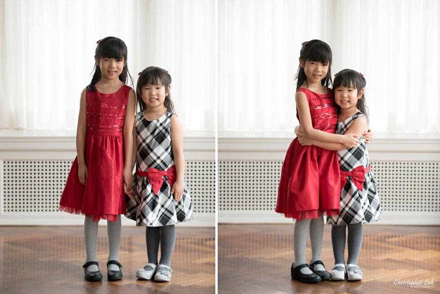 Toronto Markham Family Children Photographer - Daughters Sisters Girls Red White Grey Black Bow Dress Smile Standing Hug