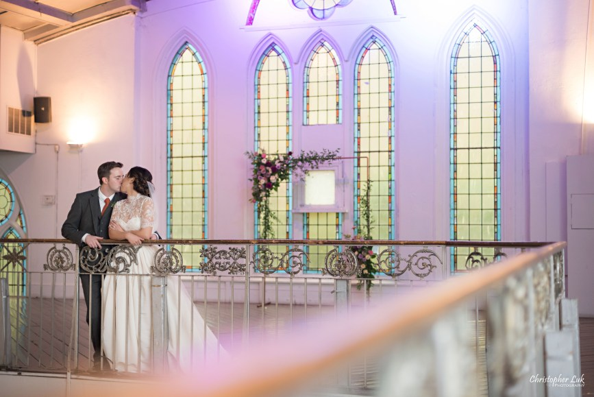 Christopher Luk (Toronto Wedding Photographer): Berkeley Church Vintage Rustic Ceremony Candlelight Dinner Reception Pinterest Worthy Details Candid Natural Photojournalistic Bride Groom Balcony Mezzanine Staircase Railing Banister Kiss