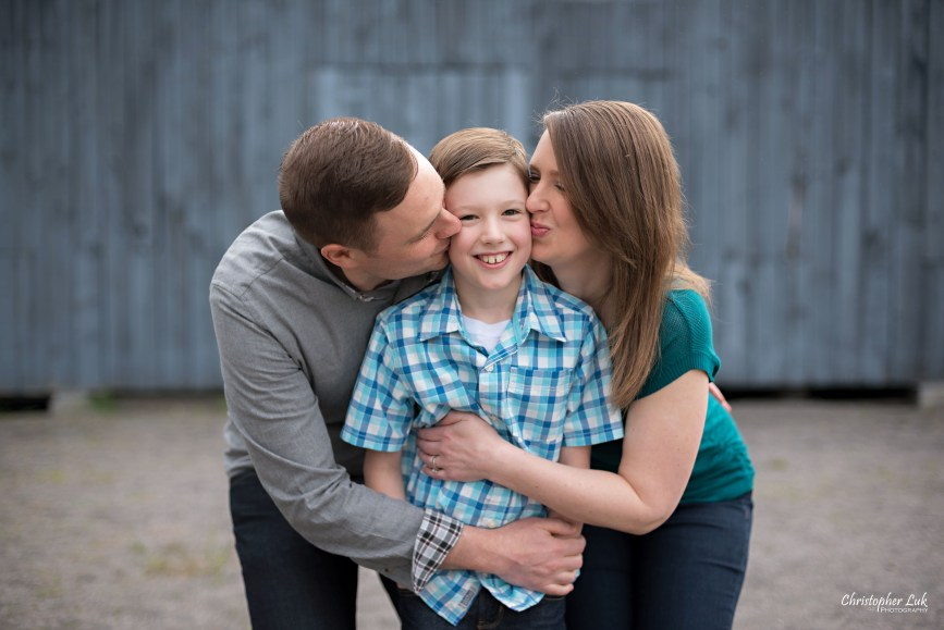 Photojournalistic Candid Natural Mom Dad Son Mother Father Hug Kiss Snuggle Cute Blue Barn