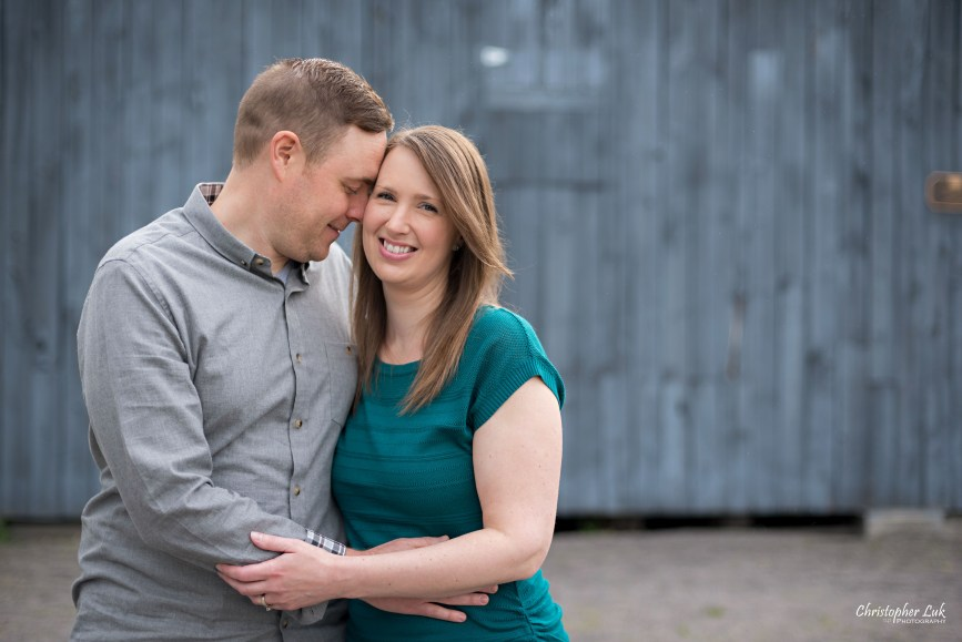 Photojournalistic Candid Natural Mom Dad Mother Father Hug Kiss Snuggle Smile Cute Blue Barn