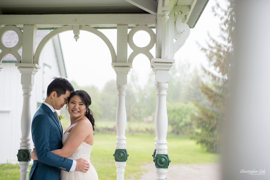 Christopher Luk: Toronto Wedding Photographer: Markham Museum Scarborough Chinese Baptist Church SCBC Columbus Event Centre Sala Caboto Natural Candid Photojournalistic Bride Groom Portrait Hug Holding Each Other Close Leading Lines Historic White Wood Home Burkholder House Covered Porch Verandah Close Up Over the Shoulder Smile