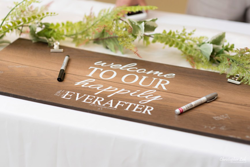 Christopher Luk - Toronto Wedding Photographer - Markham Chinese Baptist Church MCBC Christian Ceremony - Natural Candid Photojournalistic Sign In Reception Table Decor Signing Wood Wooden Board Calligraphy Welcome to Our Happily Ever After