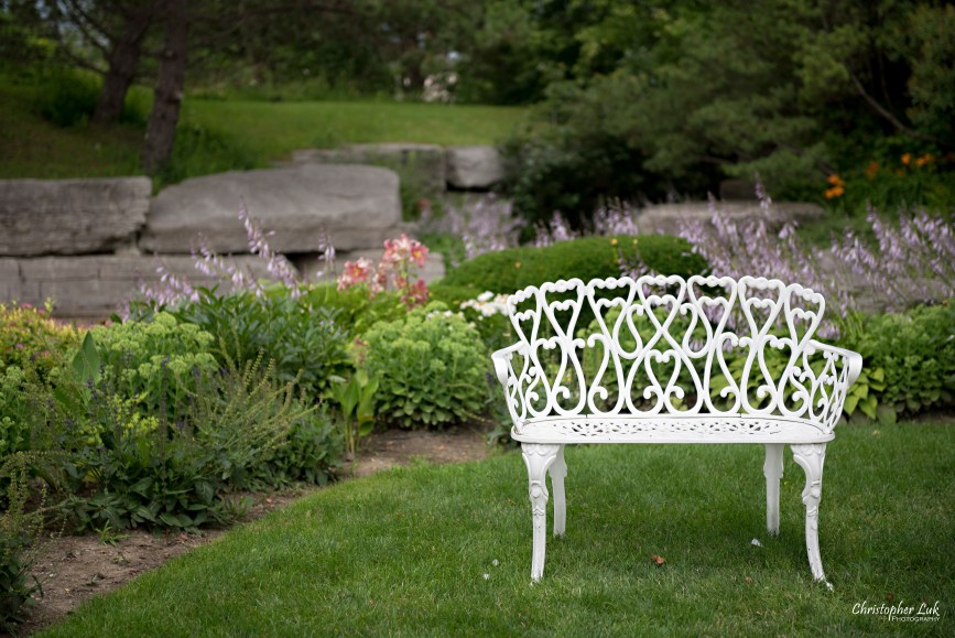 Christopher Luk - Toronto Wedding Photographer - The Manor Event Venue By Peter and Paul's - Main Grand Entrance Trees Walkway Painted White Cast Wrought Iron Bench Seat